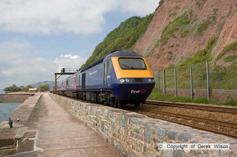 090627-017     A FGW HST set, powered by 43190 & 43180 is seen speeding away from the camera, alongside the sea wall at Teignmouth, with the 07.30 London Paddington - Penzance.