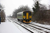 090202-009     Central green liveried class 153 no. 153385 is seen arriving at Thurgaton during a heavy snow shower with a unidentified Lincoln Central - Leicester EMT service.
