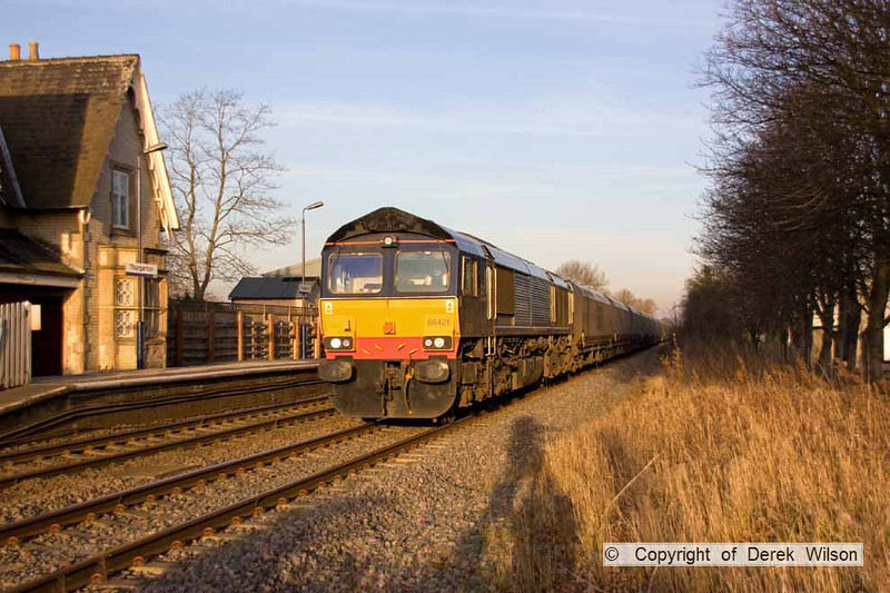 090106-010     DRS class 66/4 no. 66421 on hire to Fastline Freight is captured passing Thurgaton, powering train 6Z15, 12.15 Immingham - Ironbridge power station, loaded coal hoppers.