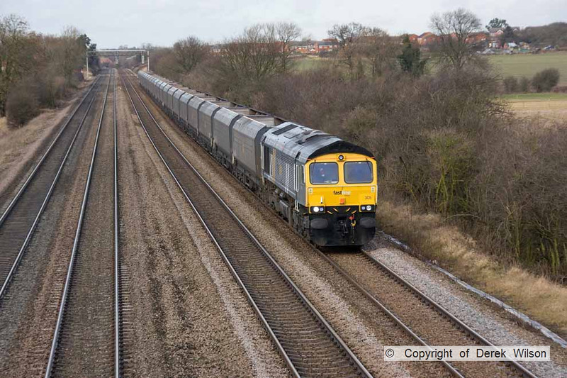 090123-014     Fastline Freight class 66 no. 66305 heads south through Cossington, powering train 4G95 Ratcliffe power station - Daw Mill colliery, empty coal hoppers.