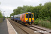 090603-010     East Midlands Trains class 156 unit no. 156403 is seen arriving at Thurgaton with the 15.25 Leicester - Lincoln Central.