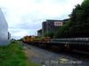 073 hauls its train over Clonminam LC. Thurs 13.08.09