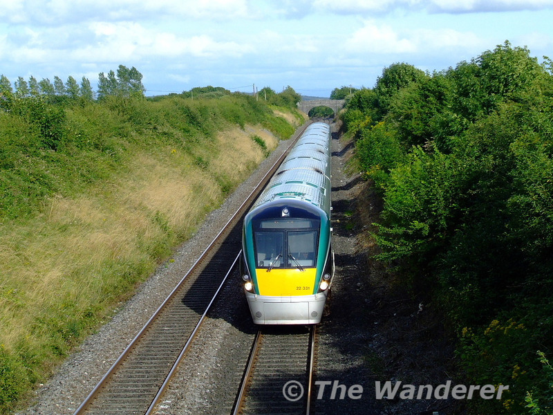 22031 hurries past Killenard with the 1725 Heuston - Limerick. Tues 04.08.09