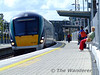 A handful of passengers await the arrival of 6 car Premier Class 22033 with the 1415 Limerick - Heuston at Portarlington. This service is normally a 3 car set on Monday's to Thursday's but was a 6 car set on Wednesday 5th August 2009