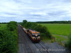 077 powers past Ratheven with a Platin - Portlaoise engineers train. Thurs 13.08.09