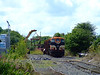 077 stands on the stub of the Killkenny branch at Clonminam in Portlaoise as a digger removes stanchions from a rake of Timber Wagons which are surplus to requirements. Thurs 06.08.09