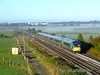 The last of the early morning mist burns off as 22037 passes Cuddagh with the 0700 Mallow - Heuston GAA Special. Sun 20.09.09
