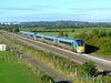 Cork allocated sets 22027 + 22024 pass Cuddagh with the late running 0630 Tralee - Heuston GAA Special. Sun 20.09.09