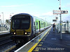 29026 with the 1535 Heuston - Newbridge at the recently opened Clondalkin / Fonthill station. Thurs 05.03.09