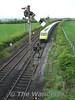 4001 is framed by the signal at Limerick Junction with the 0830 Cork - Heuston. Sun 03.05.09