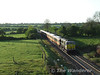 082 passes Fiddown bridge with the 0650 Waterford - Claremorris Knock Special.  Sun 03.05.09
