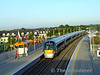 22044 arrives into platform 1 at Portarlington with the 1750 Heuston - Galway. Ballast Cleaner 780 is stabled in the up side siding. Fri 11.09.09