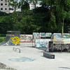 "skateboard park with all its ""tagging"", normally never found in perfectly, pristinely clean and orderly Singapore"
