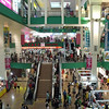 inside of giant commercial center on MRT station side of street in Chinatown
