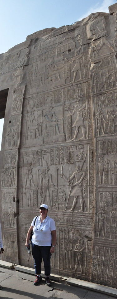 2010-11-11  045  Kom Ombo - Veronica and a Wall of Relief Carvings