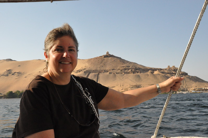 2010-11-10  227  Aswan - Veronica while Sailing on a Fluka, with the Graves of the Nobles in the Background