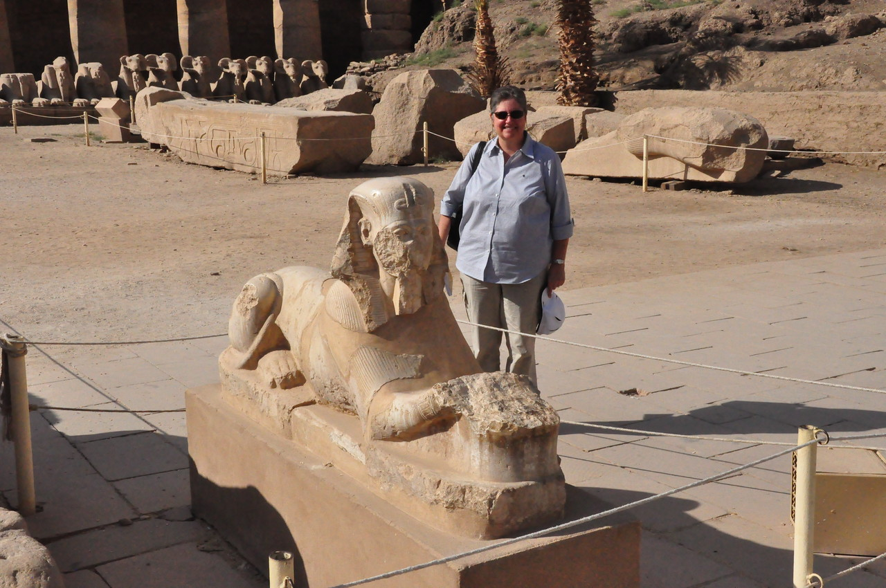 2010-11-13  019  Major Temple of Amun (Karnak) - Veronica and a Sphinx of King Tutankhamun