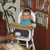 After our arrival in Walnut Creek, in the high chair that Papa used to use!