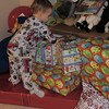 Checking out the loot.  Approximately 6:05 am or thereabouts Christmas morning.