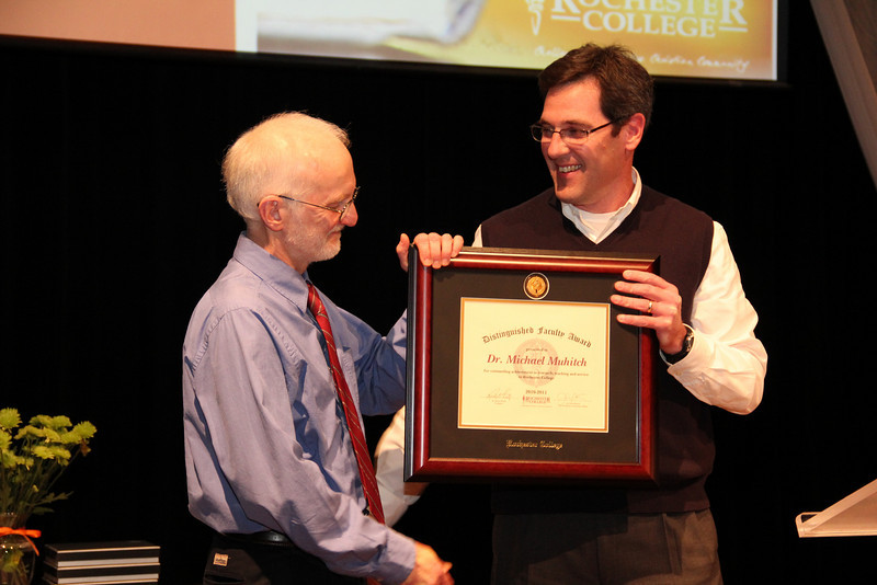 Dr. Michael Muhitch receives the distinguished faculty award.