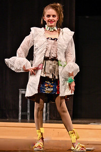 1st place Middle School team design modeled by Sophie Jeanes. The outfit-a blouse & skirt with white blazer- was crafted from shredded newspaper, braided plastic bags, and chip bags while the blazer was made of a white trash bag and leftover materials from the skirt.  The shoes were crafted from carpet remnants, ribbon, and water bottle caps. Her accessories were made by a Lower School team.  Other members of the team include Casey Nelson and Margaux Chen. Look for this outfit to be on display in Stuart's Front Hall.