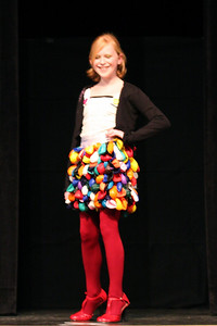 Middle School Runner-Up design modeled by Caroline McDlatchy, designed and sewn by Maddie Lapuerta. The inner layer was sewed out of a recycled sports blanket, and over 200 balloons were individually sewed and glued to make the skirt. The top is wrapped around with recycled athletic tape, and it's tied together with a large white ribbon.