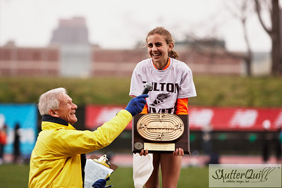 April 16, 2011. Icahn Stadium, Randall's Island, NY USA -- New York Relays Outdoor 2011.  Freshmen Mary Cain accepts her 1st place award for winning the 800m, 2:06.44.  Race announcer, Mike Rauh, interviewed her in front of the crowd at Icahn Stadium.  Her time was #1 for New York State, and #4 in the US.