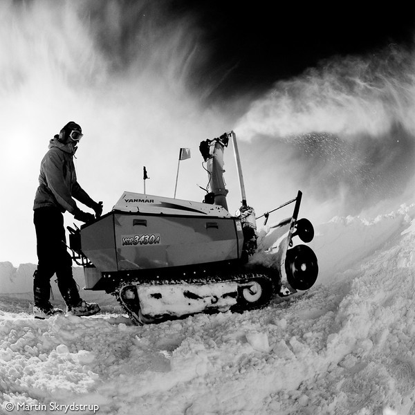 Tim working the snow blower.