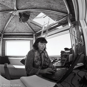 """Dorthe at the """"premier tiers"""" of the dome, used as office and ground control for incoming flights."""