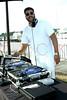 MONTAUK, NY - JULY 18:  DJ Chris Bachmann of 103.5 WKTU-FM plays music at the Hamptons Magazine annual clambake at The Montauk Yacht Club on July 18, 2010 in Montauk, New York.  (Photo by Steve Mack/S.D. Mack Pictures) *** Local Caption *** Chris Bachmann