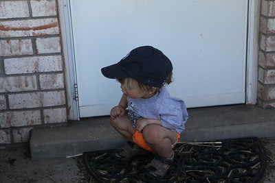 I love the way little kids squat so effortlessly to check things out
