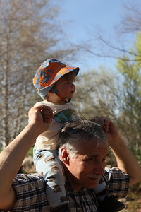 Luke so enjoyed riding around atop grandpa!