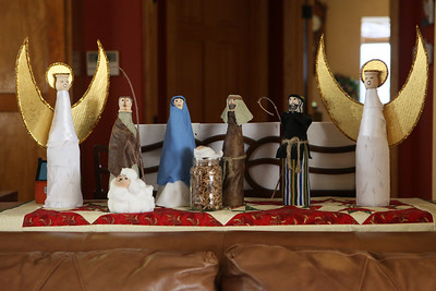 We loved their homemade nativity - the covered glass bottles with fabric and added wooden heads.