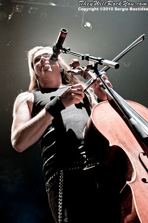 Apocalyptica strumming their cellos on the stage of the Nokia Club in Los Angeles, Calif. on Wednesday night, Sept. 8, 2010. (Photo by Sergio Bastidas/sini69photo.com, ©2010)