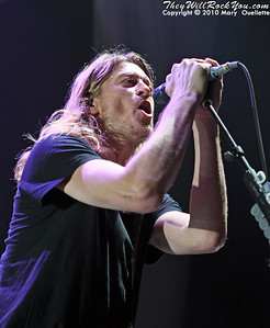 """Puddle of Mudd perform on the """"Carnival of Madness"""" tour at the Mohegan Sun Arena on August 4, 2010 in Uncasville, Connecticut."""