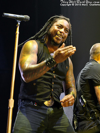 "Sevendust perform on the ""Carnival of Madness"" tour at the Mohegan Sun Arena on August 4, 2010 in Uncasville, Connecticut."