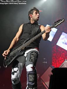 "Eric Bass of Shinedown performs on the ""Carnival of Madness"" tour at the Mohegan Sun Arena on August 4, 2010 in Uncasville, Connecticut."