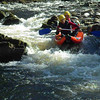 Inflatable Canoes on the River Findhorn with Ace Adventures