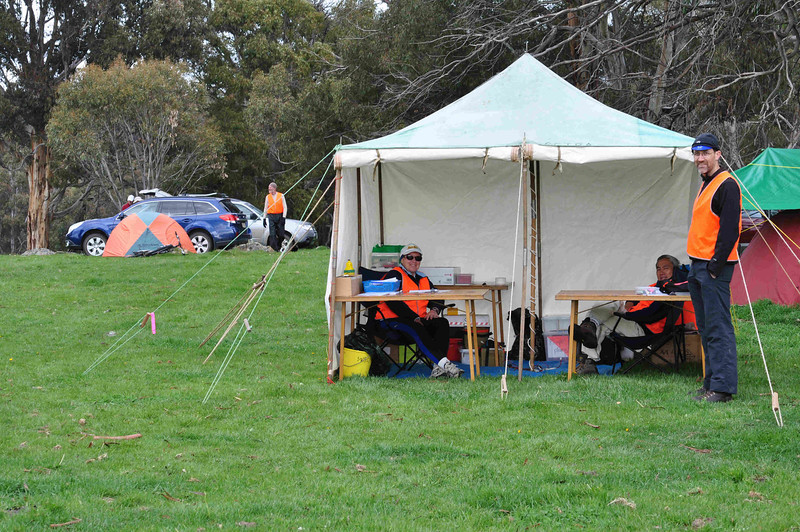 The Nungar Plain-gaine, ACT Championships, 8/24 hour, 23-24/10/10<br /> Hash House site on private property near Adaminaby<br /> Colleen, Colin, John at the admin tent for registration, Glenn in the background