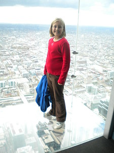 Abby Akard (Daughter of President John Akard) enjoying the glass balcony experience from the Skydeck!