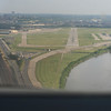Final approach to the Downtown Kansas City Airport.  Missouri river lower right.  Downtown upper left.  Photo by Connie.