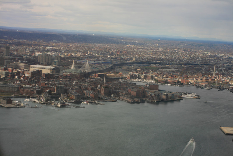 "Taken from an American Airlines flight departing Logan Airport, this is the Boston Waterfront.  Bunker Hill Monument is far right center.  The Boston Garden, where the Celtics play is the beige building left center.  Connie & I stayed one night in a hotel behind the marina just right of center of this picture, halfway between The Garden and Bunker Hill Monument, in April of 2008.  I have some pictures posted from that trip in a different gallery on this website, under ""views from our hotel room""."