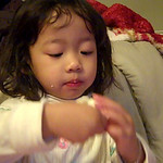 Eliana eating eggs and rice.