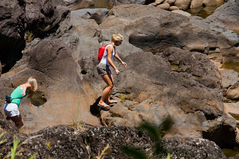 Some girls discovered flip-flops as their new hiking boots and climbed on top of the falls
