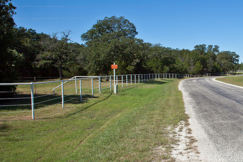 Looking West from the driveway.<br /> The lot extends to the end of the white rail fence.