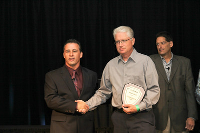 Dave Royce (l), Director of NASA Midwest and Great Lakes Regions,congratulates Brad Hille (r) on his 2010 Outstanding Contribution Award. As Great Lakes HPDE 1/2 Group Leader, Brad showed up early every event and made sure everyone in HPDE 1 received the highest quality initiation   into the program.