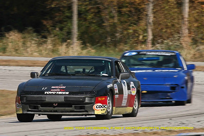 Spec 944 drivers Angel Blazquez (#17) and Sudhir Chhikara race through Turn 10 during the NASA Great Lakes & Midwest Regions season finale  weekend at Putnam Park Park Road Course, October 2010.