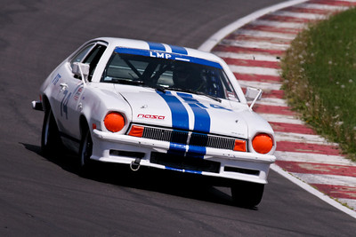 Thomas Laird's NASA Performance Touring Class (PTF) Ford Pinto rounding the banked turns at GIR, April 2010