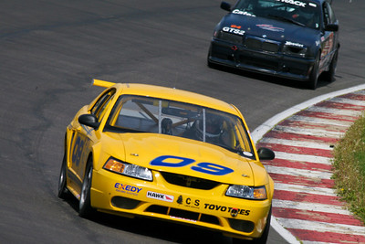 Chris Garrison's NASA Performance Touring (PTA) Mustang in action on the banked turns and front straight at GIR, April 2010