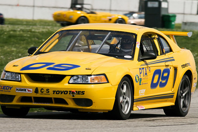 Chris Garrison's NASA Performance Touring (PTA) Mustang in action on the road course at GIR, April 2010
